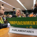 Opposition deputies talk during the presentation that analyzes the impeachment process against Brazil's President Dilma Rousseff, in Brasilia, Brazil, Wednesday, April 6, 2016. The rapporteur of an impeachment commission in the lower house of Brazil's Congress Jovair Arantes, recommended that the impeachment process against President Rousseff move forward.