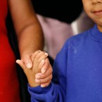 Darwin Micheal Mejia, right, holds hands with his mother, Beata Mariana de Jesus Mejia-Mejia, during a news conference following their reunion at Baltimore-Washington International Thurgood Marshall Airport, Friday, June 22, 2018, in Linthicum, Md. The Justice Department agreed to release Mejia-Mejia's son after she sued the U.S. government in order to be reunited following their separation at the U.S. border. She has filed for political asylum in the U.S. following a trek from Guatemala.