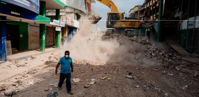 Earthmoving equipment clears debris left by the earthquake of April 16th in Portoviejo, Ecuador.