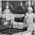 Women inspect filled boxes of Corn Flakes in the Kellogg Company factory in 1934.