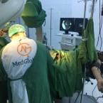 Dr. Zaher Sahloul's team at Med Global operates on an injured Yemeni man in the field.