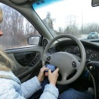 FILE - In this photo taken Dec. 15, 2009, Tina Derby sends text messages while driving in Concord, N.H.
