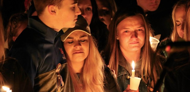 People attend a vigil on Thursday for the victims of a fatal shooting at Marshall County High School in Benton, Ky.