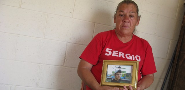 Maria Guereca in her apartment in Juarez, Mexico, holding a picture of her son, Sergio Hernandez the day the Supreme Court news came down. He was killed by a Border Patrol agent seven years ago this month. John Burnett/NPR
