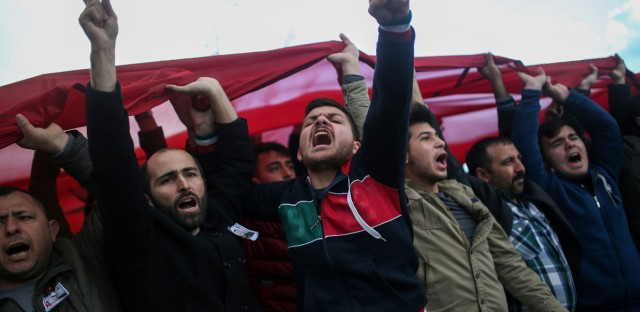 People shout slogans in support of Turkish soldiers during the funeral of Ali Akdogan in Izmir, Turkey, Sunday, Feb. 11, 2018. Akdogan was one of 12 Turkish soldiers killed Saturday during Turkey's Operation Olive Branch against the Syrian Kurdish militia that started on Jan. 20 with Ankara's cross-border incursion into the enclave of Afrin, Syria.