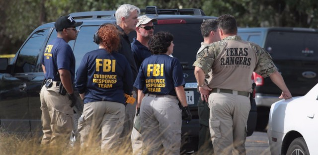 Law enforcement officials continue their investigation at the First Baptist Church of Sutherland Springs in Sutherland Springs, Texas, on Monday. On Sunday a gunman, Devin Patrick Kelley, killed 26 people at the church and wounded 20 others when he opened fire during a Sunday service. Scott Olson/Getty Images