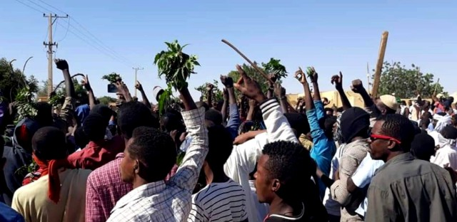 In this Sunday, Dec. 23, 2018 handout image provided by a Sudanese activist, people chant slogans during a protest in Kordofan, Sudan. The protest on Sunday was the latest in a series of anti-government protests across Sudan, initially sparked by rising prices and shortages.