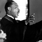 "The Rev. Dr. Martin Luther King Jr. gestures and shouts to his congregation in Ebenezer Baptist Church in Atlanta, Ga. on April 30, 1967 as he urges America to repent and abandon what he called its ""Tragic, reckless adventure in Vietnam."""