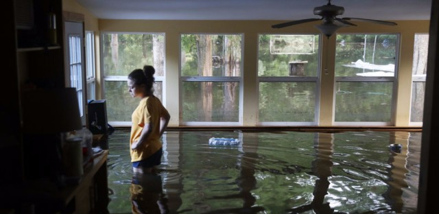 Louisiana Resident Surveys Flooding Underwater