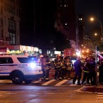 Police officers and firefighters respond to an explosion on Saturday at 23rd Street and 7th Avenue in the Chelsea neighborhood of New York City. Authorities say more than two dozen people have been taken to hospitals with injuries, none of which are thought to be life threatening.