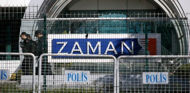Riot police officers walk by the headquarters of Zaman newspaper in Istanbul, Sunday, March 6, 2016. The European Union is facing increasing pressure to speak out against the erosion of media freedom in Turkey following the takeover of the country's largest-circulation newspaper, but few expect it to take a bold stance toward Ankara while trying to assure its help in dealing with the migration crisis. Police used tear gas and water cannons for a second day running on Saturday to disperse hundreds of protesters who gathered outside the headquarters of Zaman newspaper — now surrounded by police fences.