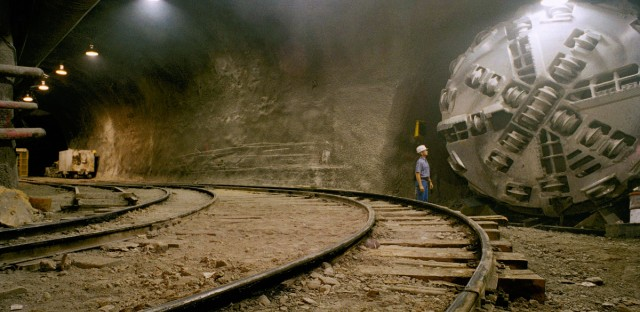 Superconducting Super Collider project manager Ricky Richards poses with a machine in the tunnel of the high-tech project near Waxahachie, Texas, on Sept 1,1993.