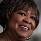 In this Jan. 11, 2011 file photo, singer Mavis Staples is shown at her home in Chicago. Stapes is nominated for a Grammy in the Best Americana category, and Staples, who has never won a the coveted trophy, says she wants to take one home at the Feb. 13 ceremony. (AP Photo/Charles Rex Arbogast)