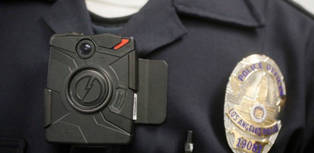 Body cameras such as this one shown on a Los Angeles Police officer will be required to be worn on patrol officers in Chicago.