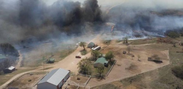 The Anderson Creek Fire threatening ranch buildings in Woods County, Okla., on Thursday. The fire has burned nearly 400,000 acres in two states.