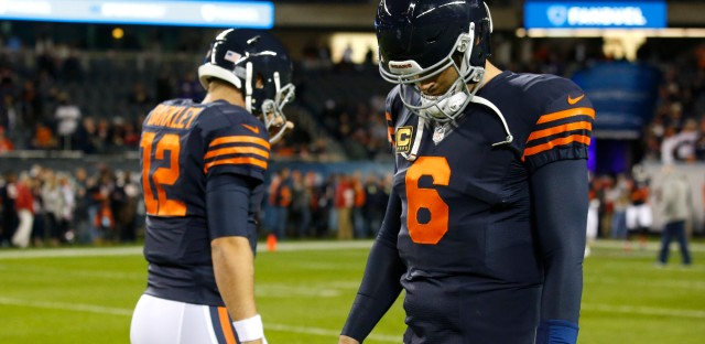 Chicago Bears quarterbacks Matt Barkley (12) and Jay Cutler (6) walk on the field during warmups before an NFL football game against the Minnesota Vikings, in Chicago on October 31, 2016.