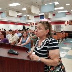 Berwyn resident Martha Reyes speaks at a special meeting called to deal with what has become a tax crisis for many.