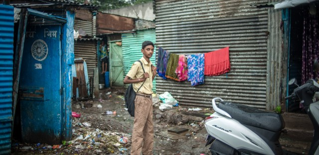 Wearing his school uniform, Aniket heads to class.
