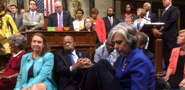 Democratic members of Congress, including Rep. Elizabeth Esty, D-Conn.(seated left), Rep. John Lewis, D-Ga. (center) as they participate in a sit-down protest seeking a vote on gun control measures on Wednesday.