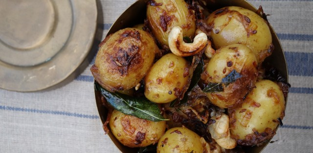 This May 15, 2016 photo shows South Indian potatoes in London. They are a distant, more tropical cousin of the classic potato salad but embellished with coastal Indian ingredients: crispy shallots, a few spices, crunchy golden cashews and a little coconut milk.