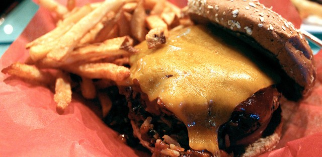 Housemade black bean and rice veggie burger with Cheddar cheese, barbecue sauce on toasted nine-grain bun with handcut fries by Levy Restaurants at Ketel One Club in United Center, Chicago