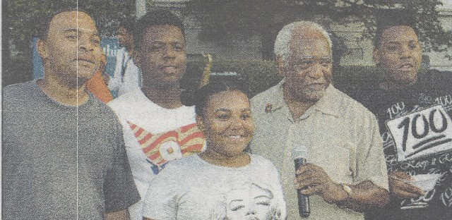 Javon Wilson,(left, white shirt) pictured in this family photo, was fatally shot Friday.
