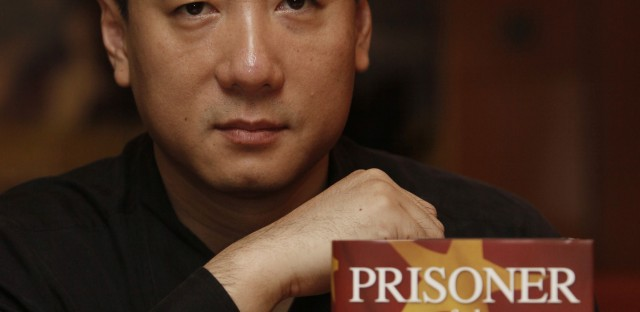 Bao Pu, shown here in 2009 with a book he edited, canceled publication in 2010 of the diary of Li Peng, China's leader during the crackdown on Tiananmen Square protesters in 1989.
