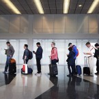 Passengers at Chicago's O'Hare International Airport wait in line for security screening in May 2016. A study released Monday found that U.S. airline quality is higher than ever, but air travelers may disagree.