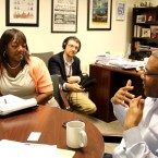 Alderman Burnett helps a local business owner find partners in his City Hall office.