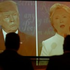 Viewers look on at the big screen television in a wine bar showing the third and final presidential debate between Democrat Hillary Clinton and Republican Donald Trump.