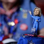 A delegate wears a hat with a bubble-head doll of Democratic Presidential candidate Sec. Hillary Clinton during the first day of the Democratic National Convention in Philadelphia , Monday, July 25, 2016.