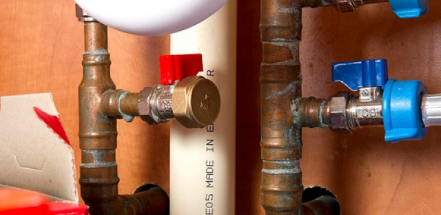 Under sink plumbing. Pipes that deliver tap water can be plastic, copper, iron and in some cases, lead.