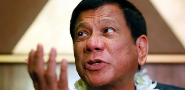 In this March 10, 2016 file photo, Davao City Mayor Rodrigo Duterte talks to the media prior to addressing seafarers organization in Manila, Philippines.