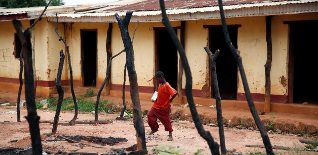 A young boy walks through a burned Muslim store in Guen, some 250 kilometers north of Bangui, Central African Republic in April 2014. A sweeping United Nations report released in May 2017 identified hundreds of human rights violations in Central African Republic that may amount to war crimes. The report comes amid growing fears that the country terrorized by multiple armed groups is once again slipping into the sectarian bloodshed that left thousands dead between late 2013 and 2015. (AP Photo/Jerome Delay-File)