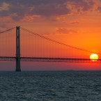 The sun sets over the Mackinac Bridge and the Mackinac Straits in May 2002. On June 29, 2017, Michigan attorney general Bill Schuette called for the shut-down of the nearly 5-mile-long section of Enbridge Inc.'s Line 5 oil pipeline under the Straits of Mackinac. (AP Photo/Al Goldis)