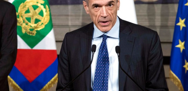 Italy's premier-designate Carlo Cottarelli addresses the media at the Quirinale presidential palace in Rome, Thursday, May 31, 2018. Cottarelli, a former IMF official tapped to lead Italy's government until a new election could be held has stepped aside, paving the way for a political government of populists. (Francesco Ammendola/Italian Presidency via AP)