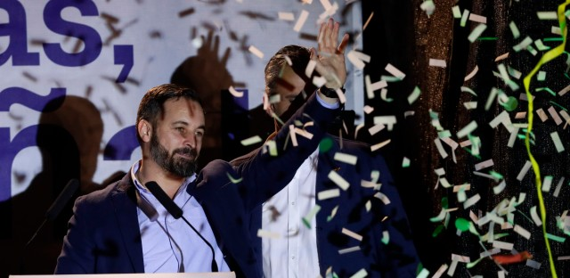 Santiago Abascal, leader of far right party Vox, waves to supporters gathered outside the party headquarters following the general election in Madrid, Sunday, April 28, 2019. A divided Spain voted Sunday in its third general election in four years, with all eyes on whether a far-right party will enter Parliament for the first time in decades and potentially help unseat the Socialist government.