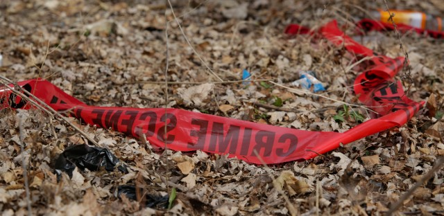 Police tape litters the ground after a Feb. 14, 2017, shooting in Chicago that that killed a toddler and a man authorities said was the intended target.