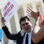 Six-year-old Sophie Cruz speaks during a rally in front of the Supreme Court next to her father, Raul Cruz, and supporter Jose Antonio Vargas in 2016.