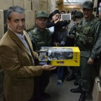 A photo released by Venezuelan government agency Sundde shows the group's head, William Contreras, with one of the toys that have been seized from a distributor's warehouses in Caracas.