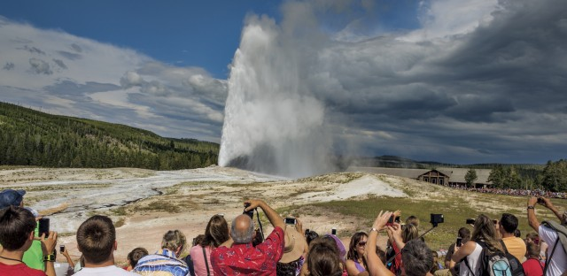 """Almost like clockwork, every 60 to 110 minutes, Old Faithful shoots out a jet of steam and hot water up to 184 feet high. In summer the nearby parking lot fills and empties at about the same pace. Yellowstone Superintendent Dan Wenk says, """"One of the great fears of every superintendent of Yellowstone is that Old Faithful will stop erupting when they're superintendent."""""""