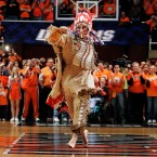 In this Feb. 21, 2007 file photo, University of Illinois mascot Chief Illiniwek performs for the last time during an Illinois basketball game in Champaign, Ill.