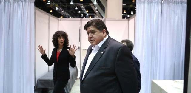Illinois Gov. JB Pritzker tours Hall C Unit 1 of the COVID-19 alternate site at McCormick Place in Chicago on Friday.