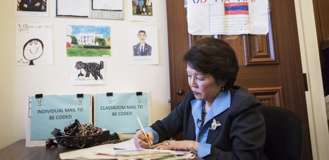 Patty Shinseki, a volunteer in the Office of Presidential Correspondence, reads letters from children to President Obama in the kids mailroom in the Eisenhower Executive Office Building in Washington, D.C.