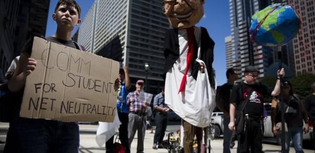 Protesters in Philadelphia demonstrate in favor of net neutrality across the street from the Comcast Center in Philadelphia.