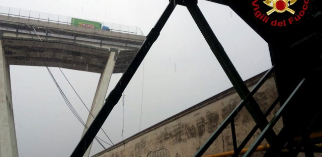 Italy's national firefighter corps posted an image taken from below the collapsed span, showing a truck stopped just feet from where the bridge trails off into the open air.