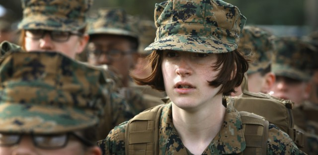 Marine recruit Haley Evans stands in formation during boot camp at Marine Corps Recruit Depot Parris Island, S.C., in 2013.