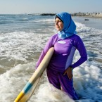 Sama Wareh walks along the sand dressed in swimwear designed for Muslim women Newport Beach, Calif.