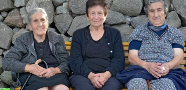 <p>Constantina Mesisklis, center, and two friends at Skala Sykaminia in Lesbos, Greece.</p>