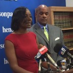 Rhonda Crawford (left) stands next to her attorney Victor Henderson. She says she will continue to run in the upcoming judicial election.